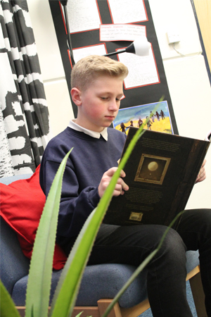 A pupil reading a book