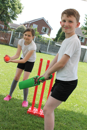 2 Pupils playing cricket