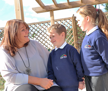 Our headteacher talking with 2 pupils